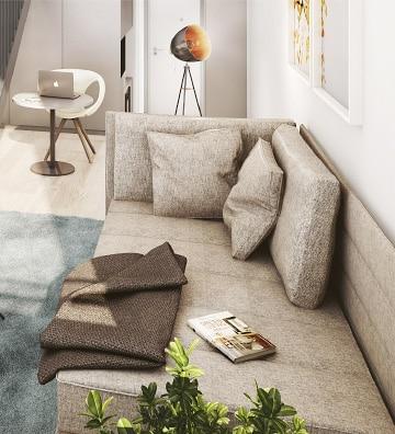 kleines studiomuc apartment mit sessellandschaft und decke